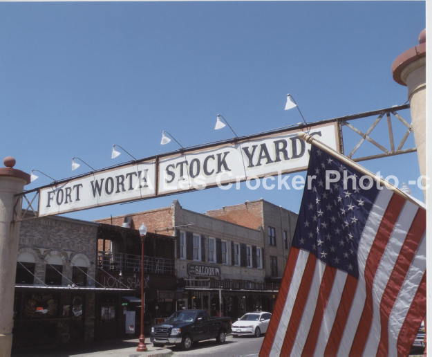 Item # 123 The Fort Worth Stock Yards Sign and U.S. Flag. Photo by Les