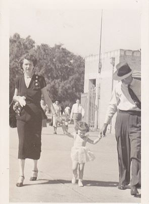 This is me, Cathy Holtzer Elton with my Mom and Daddy, Annette and Otto Holtzer. It was taken in 1952 in front of the Will Rogers Coliseum, I believe. It looks like the middle of Summer, so I have no idea what was going on.