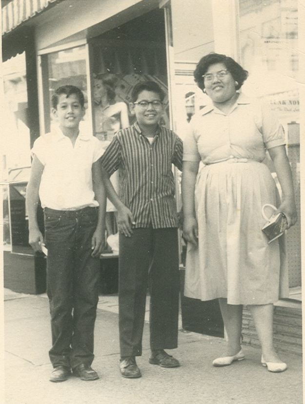 This is Joe Rodriques in the middle, his sister Rita and his friend Jessie on a shopping trip in the early 50's. Was taken in front of either Leonard's or Everybody's Dept. store.