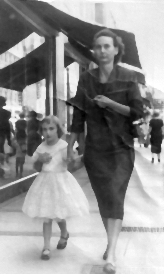 This is my favorite picture of my mother, Fannie (Rudy) Collum Huffman and me. It is probably around 1959. Baker's Shoe Store is behind us. Probably hurrying to catch a bus. Thanks, Ruby (Huffman) Bruce