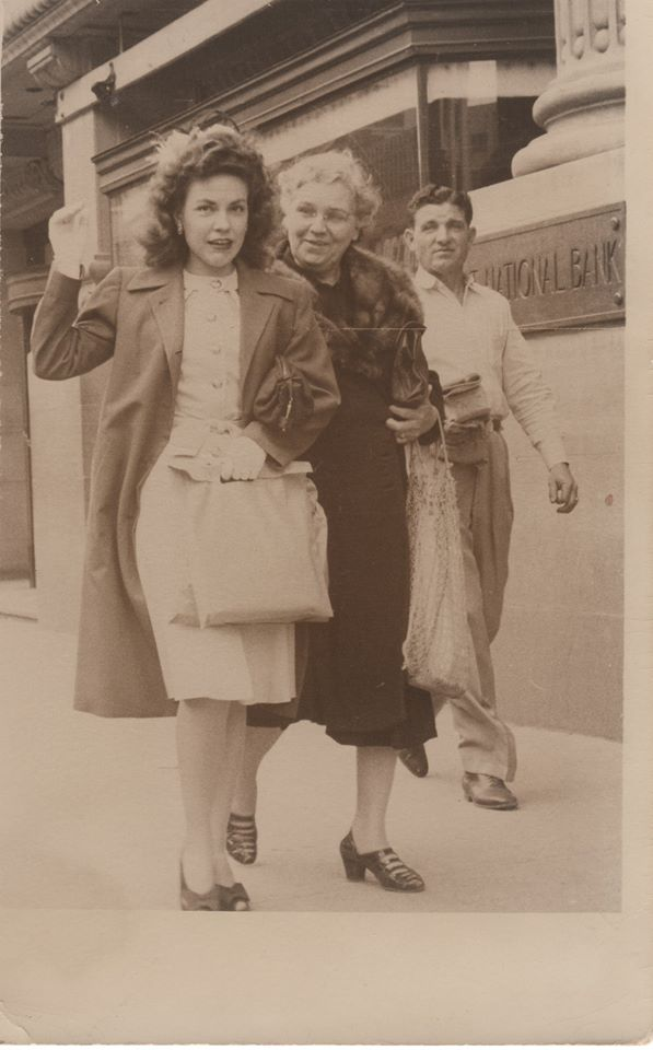 The little girl is my step-mother Ann Labaume Smith. Based on her age in the picture it would be just before WWII maybe 1940. The lady waving at the camera is my mother Floy Bedwell Smith and the woman over her shoulder is her mother Olive Bedwell. This is probably 1940 as well. Both pictures were taken on the downtown streets of Fort Worth, Texas.