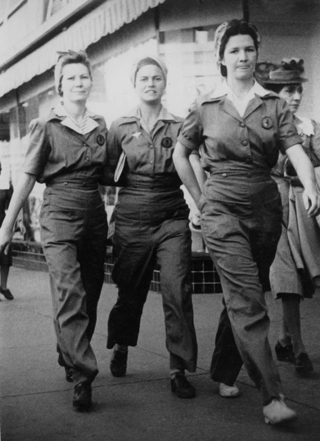 "Traces of Texas reader Wanda Cronauer's photo of her mom, Willie Mae Greer, with two friends on Houston Street in Fort Worth back in 1942. All three were ""Rosie the Riveters"" at the North American plant there. They worked on the P-51 Mustang Fighter. The photo was taken by a street photographer in downtown Fort Worth. According to the note left on the photo by Wanda's mom, they were headed to Leonard's to buy a dress for her as she had a date with a man named Larry Lenz. That's three nice lookin' Texas ladies there. No wonder we won the war, with gals like these making planes!"
