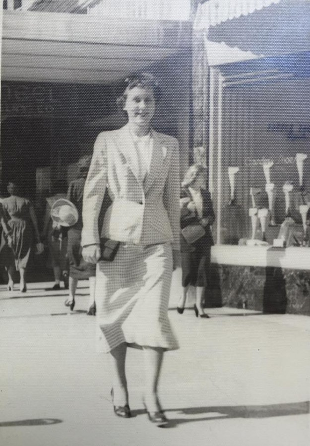 Old pic of my mother-in-law, Darlene Robbins who passed away suddenly in February of last year. Anyone recognize the location? Chandler's Shoes, I think, there to the right. --neel Jewelry Co (maybe) in the background to the left. Back of the pic says 1950's. Contributed by Mark Oxer