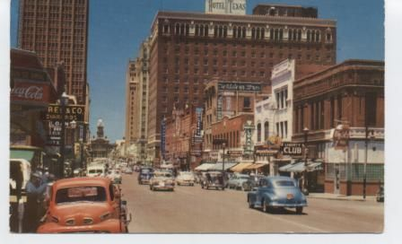Main Street featuring Texas Hotel and Tarrant County Courthouse.